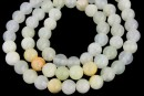 Rainbow jade, round, white, 6.5mm
